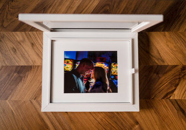 white box with matted photographic prints taken on wedding day